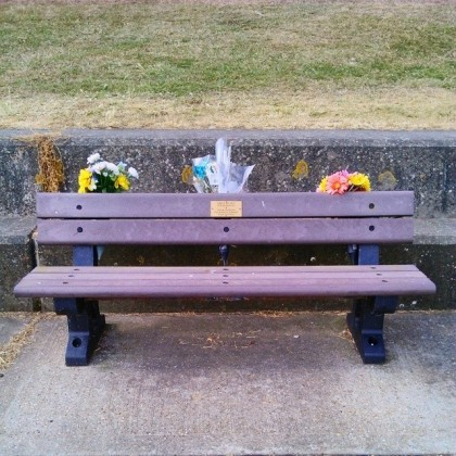 Memorial benches line the beach seafront